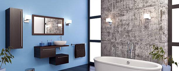 Modern blue bathroom, tub, and sink