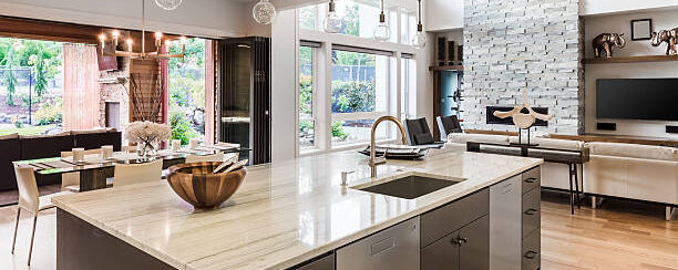 Kitchen with Island, Sink, Cabinets, and Hardwood Floors in Luxury Home