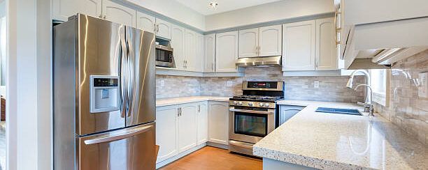 Luxury kitchen, white cabinets, Corian counter, stainless steel appliances